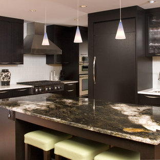 Contemporary kitchen photos - Inspiration for a contemporary kitchen remodel in Seattle with glass tile backsplash, white backsplash, paneled appliances, an undermount sink, flat-panel cabinets and dark wood cabinets