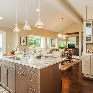 Transitional l-shaped medium tone wood floor and brown floor open concept kitchen photo in Seattle with an undermount sink, shaker cabinets, beige cabinets, quartzite countertops, stainless steel appliances and an island