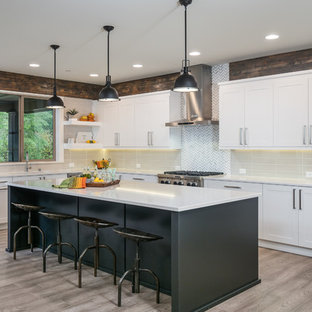 Farmhouse kitchen designs - Kitchen - farmhouse l-shaped dark wood floor and brown floor kitchen idea in Seattle with shaker cabinets, white cabinets, an island, gray backsplash and stainless steel appliances