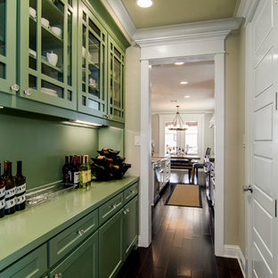 Design ideas for a traditional kitchen in Dallas with glass-front cabinets, green cabinets, green splashback and green benchtop.