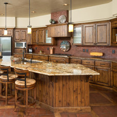 Rustic Kitchen by Sun Forest Construction
