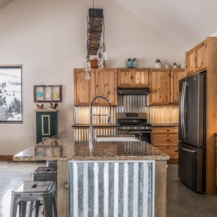 Medium sized rustic l-shaped kitchen/diner in Seattle with shaker cabinets, light wood cabinets, an island, a belfast sink, metallic splashback, stainless steel appliances, concrete flooring, grey floors, multicoloured worktops and granite worktops.