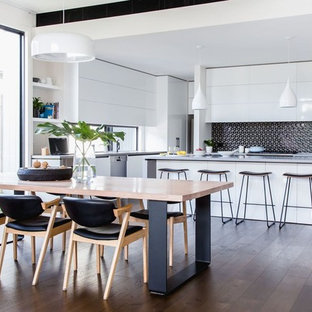 Inspiration for a contemporary l-shaped kitchen in Melbourne with flat-panel cabinets, white cabinets, black splashback, mosaic tile splashback and an island.