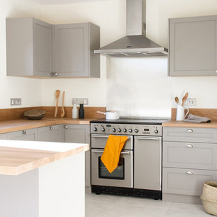 Inspiration for a medium sized traditional u-shaped enclosed kitchen in Other with a submerged sink, shaker cabinets, grey cabinets, wood worktops, metallic splashback, stainless steel appliances, grey floors and no island.