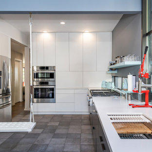 Inspiration for a mid-sized contemporary u-shaped ceramic floor and gray floor kitchen remodel in San Francisco with a single-bowl sink, flat-panel cabinets, gray cabinets, quartz countertops, white backsplash, quartz backsplash, stainless steel appliances, white countertops and no island