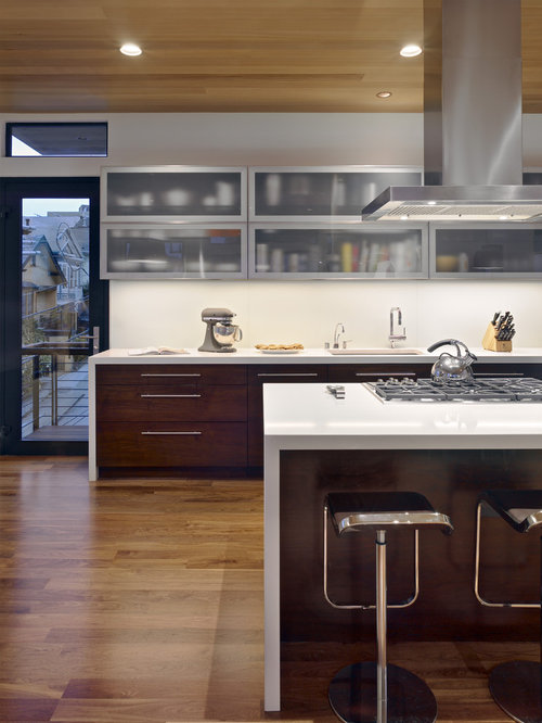 Trendy Kitchen Photo In San Francisco With Glass Front Cabinets And Dark Wood Cabinets