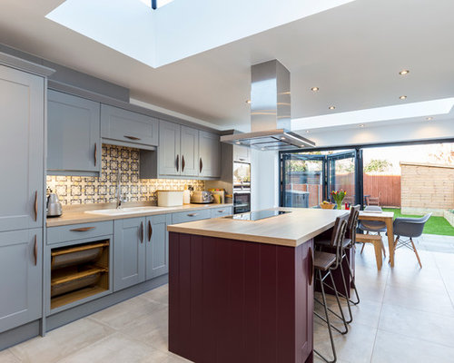 Example Of A Large Transitional Single Wall Eat In Kitchen Design In London  With