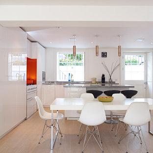 Bespoke, basement, white-gloss kitchen with orange accents
