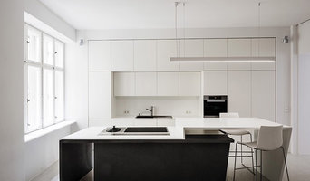 Bespoke Corian and fibre concrete kitchen working perfectly with room geometry,