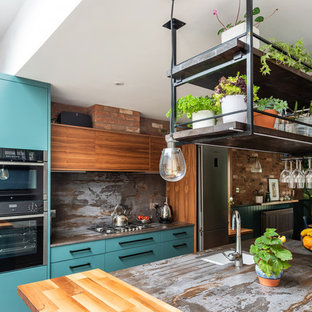 Photo of a mid-sized contemporary galley eat-in kitchen in Other with a drop-in sink, flat-panel cabinets, turquoise cabinets, quartzite benchtops, metallic splashback, slate splashback, stainless steel appliances, porcelain floors, with island, white floor and multi-coloured benchtop.