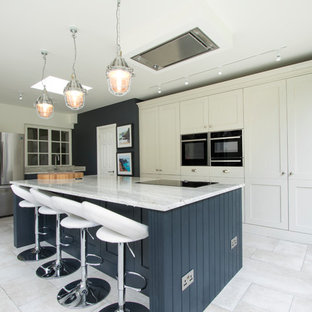Inspiration for a medium sized classic l-shaped kitchen in Other with a submerged sink, an island, white floors, shaker cabinets, blue cabinets and stainless steel appliances.