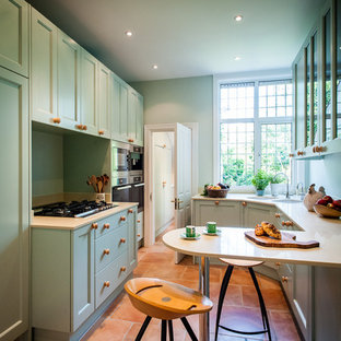 Design ideas for a small traditional galley kitchen in Kent with shaker cabinets, green cabinets, stainless steel appliances, a breakfast bar, granite worktops, terracotta flooring and beige worktops.