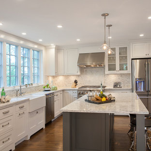 Large traditional eat-in kitchen designs - Inspiration for a large timeless l-shaped dark wood floor and brown floor eat-in kitchen remodel in DC Metro with shaker cabinets, granite countertops, white backsplash, mosaic tile backsplash, stainless steel appliances, an island, a farmhouse sink and white cabinets
