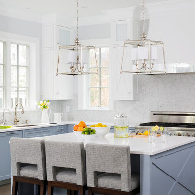 Kitchen - large transitional l-shaped dark wood floor and brown floor kitchen idea in DC Metro with an undermount sink, recessed-panel cabinets, blue cabinets, quartz countertops, gray backsplash, mosaic tile backsplash, stainless steel appliances, an island and white countertops