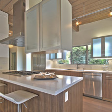 Midcentury Kitchen by Classical Progression Inc.