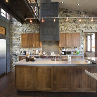 Urban kitchen photo in Denver with stainless steel appliances, shaker cabinets, dark wood cabinets and an undermount sink