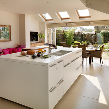 Bi-fold doors open the bulthaup kitchen into the garden of this London Town Hous