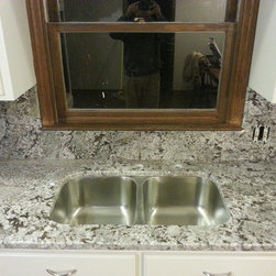 Bianco Antico Counter-top and full height granite back splash - Project costs $4035.00, (include Bianco Antico material, labor, 1/4 round edge, 50*50 stainless steel under-mount sink)