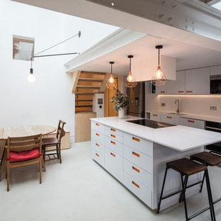 Scandinavian kitchen/diner in London with a submerged sink, flat-panel cabinets, grey cabinets, white splashback, an island, grey floors and white worktops.