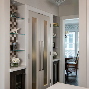 Inspiration for a mid-sized contemporary l-shaped kitchen pantry in Birmingham with recessed-panel cabinets, quartz benchtops, glass tile splashback, stainless steel appliances, dark hardwood floors, with island, dark wood cabinets, white benchtop, multi-coloured splashback, brown floor and a farmhouse sink.