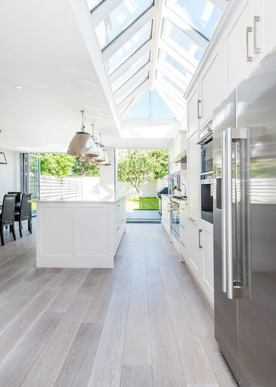 Transitional Kitchen by CATO creative Ltd