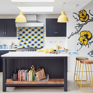 Design ideas for a medium sized contemporary l-shaped open plan kitchen in Other with shaker cabinets, blue cabinets, an island, multi-coloured splashback and beige floors.