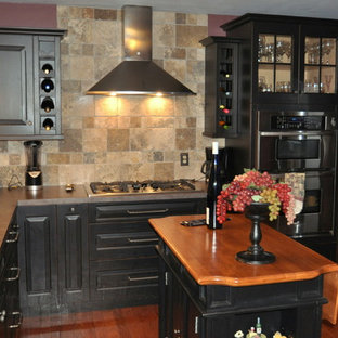 Eat-in kitchen - transitional l-shaped eat-in kitchen idea in Chicago with an undermount sink, raised-panel cabinets, black cabinets, laminate countertops, beige backsplash, stone tile backsplash and stainless steel appliances