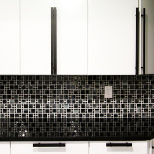 Photo of a large modern l-shaped separate kitchen in Philadelphia with an undermount sink, flat-panel cabinets, white cabinets, quartz benchtops, multi-coloured splashback, glass tile splashback, stainless steel appliances, ceramic floors, with island, multi-coloured floor and black benchtop.