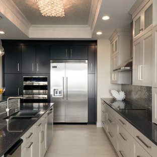 Mid-sized minimalist l-shaped ceramic tile eat-in kitchen photo in Miami with an undermount sink, flat-panel cabinets, white cabinets, quartz countertops, multicolored backsplash, mosaic tile backsplash, stainless steel appliances and an island