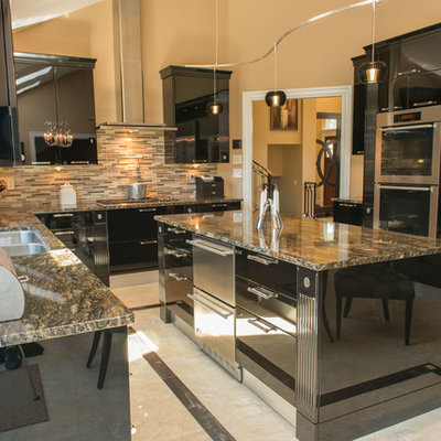 Kitchen - contemporary kitchen idea in New York with stainless steel appliances, flat-panel cabinets and black cabinets
