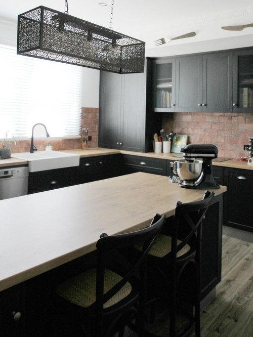 Küchen mit Rückwand aus Backstein und Laminat-Arbeitsplatte Ideen ...