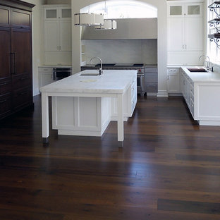 Contemporary kitchen pictures - Example of a trendy brown floor kitchen design in Chicago
