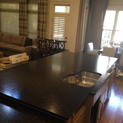Large transitional u-shaped medium tone wood floor eat-in kitchen photo in Atlanta with a single-bowl sink, raised-panel cabinets, beige cabinets, granite countertops, multicolored backsplash and stainless steel appliances