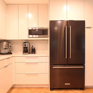 Black Stainless Steel Counter Depth Refrigerator and Hanging Microwave