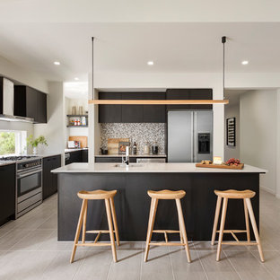 Inspiration for a scandinavian l-shaped kitchen in Central Coast with an undermount sink, flat-panel cabinets, black cabinets, window splashback, stainless steel appliances, with island, beige floor and white benchtop.