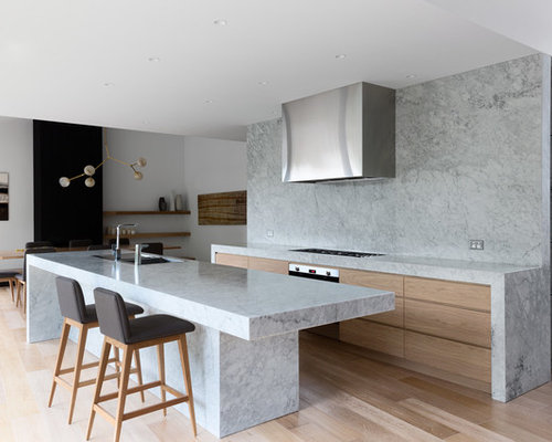 Photo Of A Modern Kitchen In Melbourne With White Splashback, Stone Slab  Splashback And An