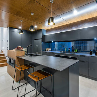 Inspiration for a contemporary galley kitchen in Canberra - Queanbeyan with a drop-in sink, flat-panel cabinets, grey cabinets, window splashback, black appliances, with island, grey floor and grey benchtop.