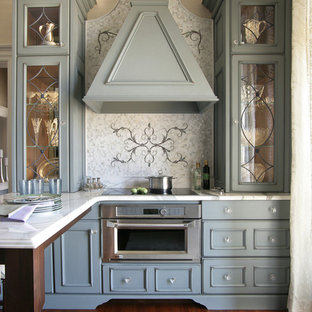 Small victorian u-shaped eat-in kitchen in New York with a drop-in sink, stainless steel appliances, medium hardwood floors, with island, recessed-panel cabinets, blue cabinets, marble benchtops, white splashback and marble splashback.