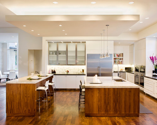 Example of a trendy galley open concept kitchen design in Other with ...