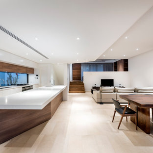 Large contemporary galley open plan kitchen in Perth with a double-bowl sink, flat-panel cabinets, white cabinets, window splashback, panelled appliances, with island, beige floor and white benchtop.