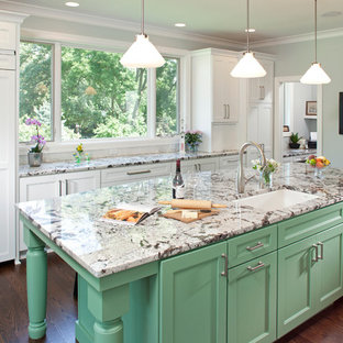 Design ideas for an expansive traditional galley eat-in kitchen in Minneapolis with an undermount sink, recessed-panel cabinets, green cabinets, panelled appliances, dark hardwood floors, granite benchtops, multi-coloured splashback, subway tile splashback and with island.