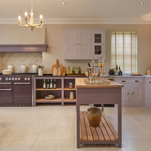 Large traditional eat-in kitchen ideas - Example of a large classic l-shaped porcelain floor eat-in kitchen design in Wiltshire with an undermount sink, raised-panel cabinets, marble countertops, colored appliances and an island