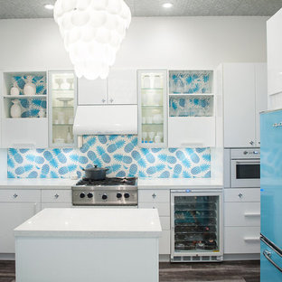 This is an example of a contemporary l-shaped kitchen in San Francisco with flat-panel cabinets, white cabinets, blue splashback, coloured appliances and with island.