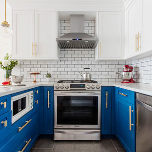 Small transitional eat-in kitchen remodeling - Example of a small transitional u-shaped gray floor eat-in kitchen design in New York with recessed-panel cabinets, blue cabinets, white backsplash, subway tile backsplash, stainless steel appliances, a peninsula and a farmhouse sink