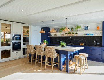 Blue coastal-inspired kitchen with rattan and wicker décor