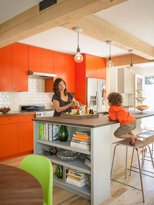 Kitchen design ideas renovations photos with orange cabinets and an island - Modern kitchen cabinets orange county ...