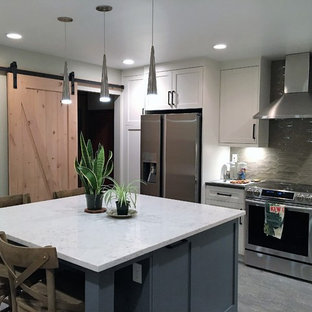 Mid-sized craftsman eat-in kitchen ideas - Mid-sized arts and crafts l-shaped vinyl floor and blue floor eat-in kitchen photo in Portland with an undermount sink, shaker cabinets, blue cabinets, quartz countertops, beige backsplash, glass tile backsplash, stainless steel appliances, an island and multicolored countertops