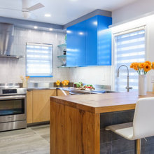 Sky-Blue Cabinets and Clever Wine Storage Make for a Cool Kitchen
