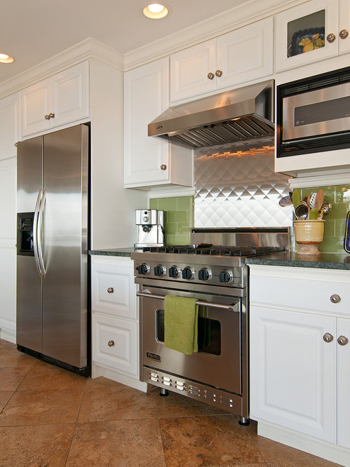Example of an eclectic kitchen design in Denver with stainless steel  appliances