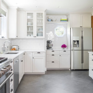 Mid-sized traditional kitchen appliance - Example of a mid-sized classic l-shaped porcelain floor kitchen design in Seattle with an undermount sink, white cabinets, quartz countertops, white backsplash, subway tile backsplash, stainless steel appliances and beaded inset cabinets